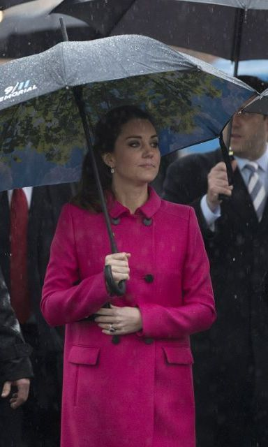 Kate kept warm in a cerise-colored wool and silk coat from Mulberry when touring the 9/11 Memorial and Museum. 