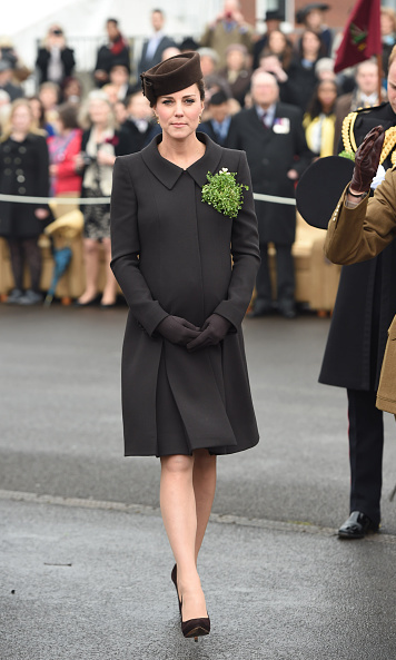 Kate donned a brown Catherine Walker coat as opposed to the customory green at the traditional St. Patrick's Day parade, March 2015.