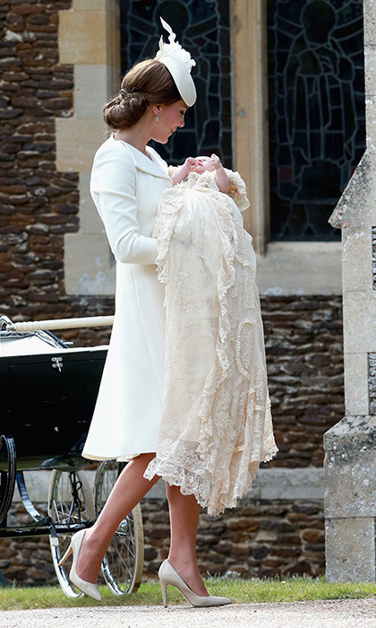 As Kate looked adoringly at her gorgeous baby Princess Charlotte, we all looked on admiringly at her sophisticated cream Alexander McQueen dress coat that she wore to her daughter's christening in July 2015.