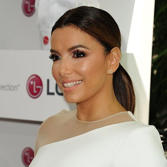 Eva Longoria chose a wet look low style to complement her long eyelashes and smokey eye makeup.