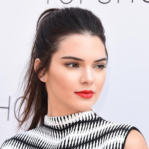 Kendall Jenner kept a few strands loose as she swept her hair back for a laidback chic finish.