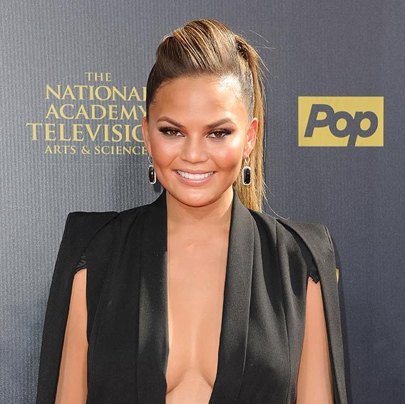 Chrissy Teigen added a touch of edge to her hairstyle with a quiff full of volume.