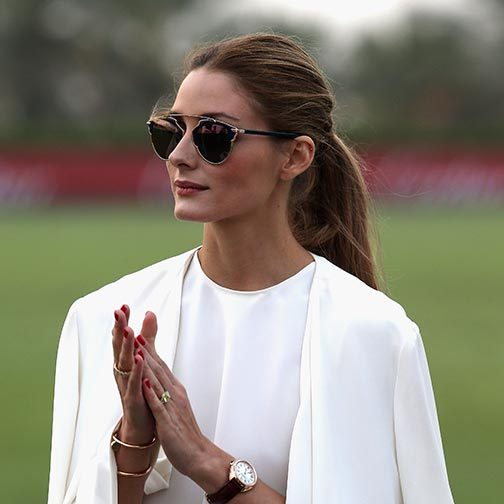 Olivia Palermo was the epitome of elegance at the International Dubai Polo Challenge with her hair swept back into a loose ponytail.<br>