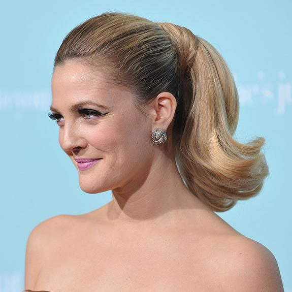 Drew Barrymore could have stepped out of old Hollywood with her chic updo complemented by dramatic winged eyeliner.