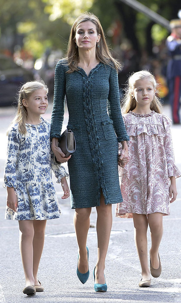Months later, Queen Letizia and her little Princesses were picture perfect at Spain's National Day military parade. <br>