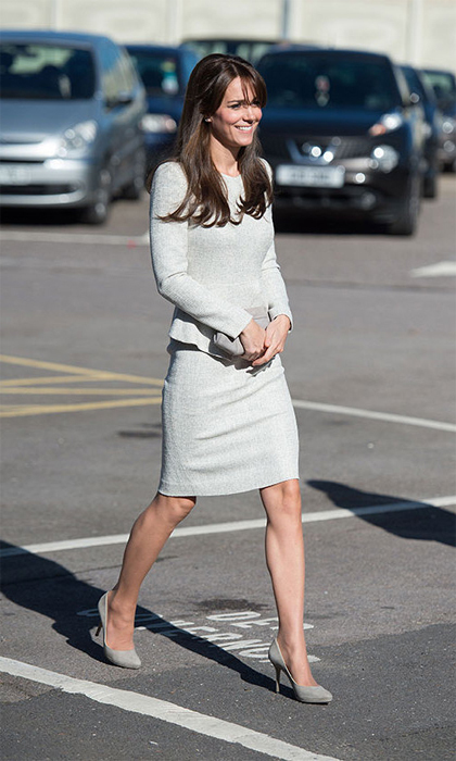 Continuing her royal duties, the Duchess visited a women's prison wearing this creation by little-known London-based label The Fold. The tailored pale grey dress, called 'The Eaton', features long sleeves, a V-neckline, a peplum bodice and a pencil skirt. It is priced at £365, or around $550. <br>
