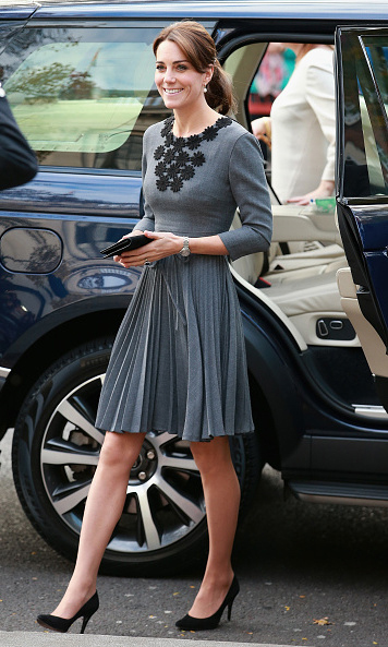 Accessory fans take note: the royal brunette accessorized her grey Orla Kiely dress with black suede Jimmy Choo pumps, Links of London 'Hope Egg' earrings and a black Mulberry clutch. <br>