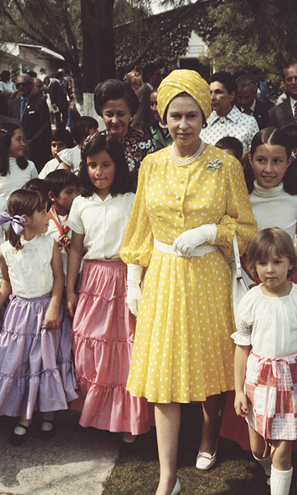The Queen was a ray of sunshine in a yellow polka-dot ensemble with a group of local children during her state visit to Mexico in 1975.