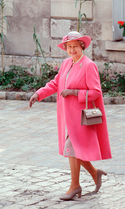 During a visit to Blois in France, The Queen wore a pink and taupe outfit designed by Ian Thomas in 1992.