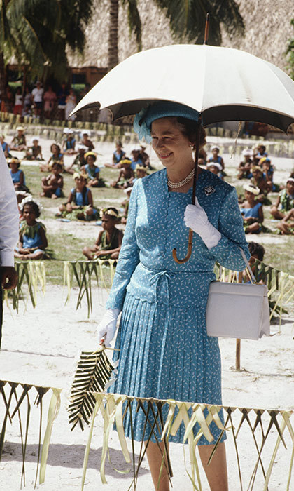 The Queen blocked the sun with a stylish weather accessory outside of the Princess Margaret Hospital in Funafuti, Tuvalu in 1982.