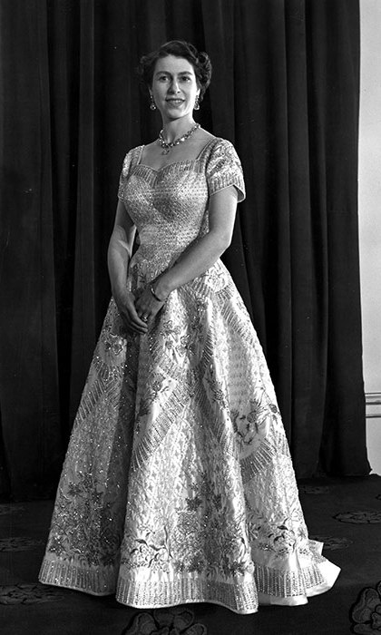 In 1953, the Queen wore a gown designed by Sir Norman Hartnell for her coronation ceremony.