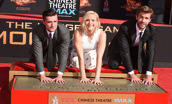 October 31: Josh Hutcherson, Jennifer Lawrence and Liam Hemsworth cemented their places in movie history at the 'Hunger Games: Mockingjay – Part 2' hand and footprint ceremony at the TCL Chinese Theatre  in Hollywood. <br><br>