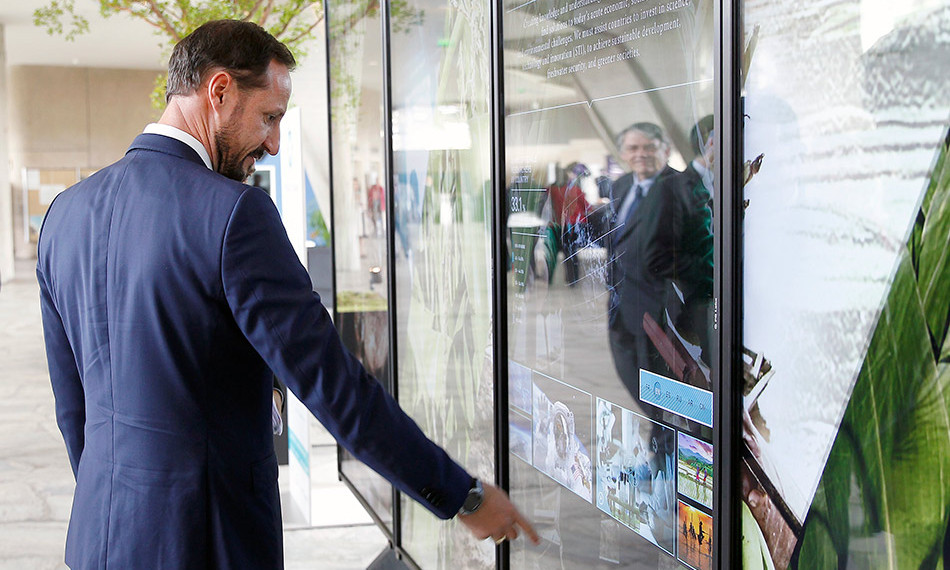 Crown Prince Haakon of Norway was interactive with a touch-screen information board prior to attending the 38th session of the UN Educational, Scientific and Cultural Organization at the UNESCO headquarters in Paris. <br>Photo: Getty Images