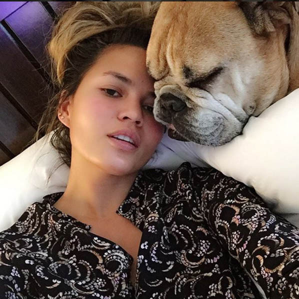 Lounging around makeup free with a top knot and our canine BFF - we can all relate to Chrissy Teigen! 