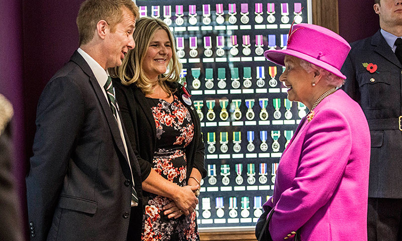 Queen Elizabeth talked to the parents of Lance Corporal James Brynin, who were presented with the Elizabeth cross following the death of their son in Afghanistan in 2013. The royal meeting took place during a visit to the medal room in the Ministry of Defence medal office in Gloucestershire, England. 