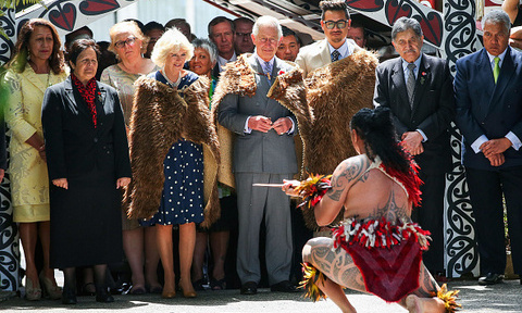 Prince Charles and Duchess of Cornwall were all wrapped up as they watched a Maori warrior during a visit to Turangawaewae Marae in New Zealand.