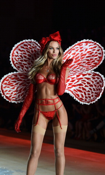 The lady in red a.k.a Candice Swanepoel sent a kiss down the runway at the 2012 show.
