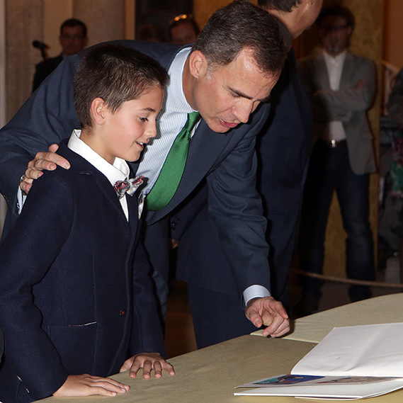 King Felipe of Spain read with a young student as he met with winners of the 'What Does Being A King Mean To You?' contest at the Pardo Palace in Madrid.