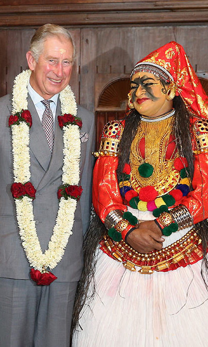 Prince Charles talked to a dancer in traditional attire after a performance at the cultural museum in Kochi.