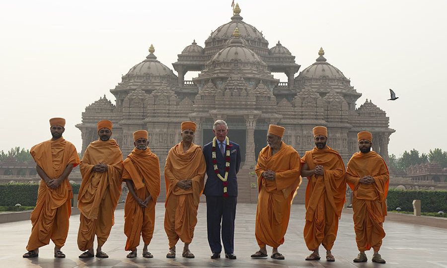 The future King also posed with priests during a visit to Akshardham temple in New Delhi.