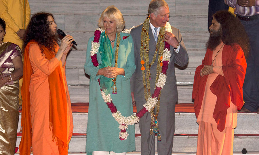 Charles and Camilla take part in an Aarti ceremony at the Parmarth Niketan Temple in 2013 on the banks of the River Ganges in Rishikesh.