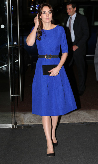 Despite the cold weather, the Duchess stepped out wearing a gorgeous a cobalt blue Saloni crinkle-effect dress to present awards at the annual Fostering Excellence Awards in London. <br>