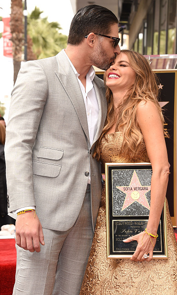 The 'Magic Mike' star plants a smooch on his fiancée's forehead after she was honored with a star on the Hollywood Walk of Fame (though something tells us these two already had stars in their eyes long before).