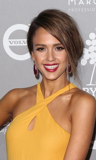 Like Jessica Alba, opt for a dramatic side part and sweep your hair into a low chignon.