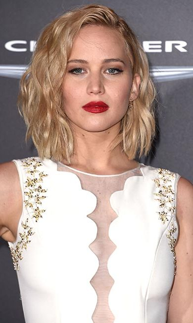 If you're rocking a short bob like Jennifer Lawrence, wear it down in loose tousled waves for an edgy style.