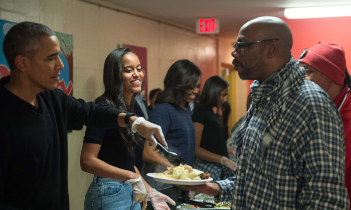 The Obama family was all smiles as they served up Thanksgiving dinner at homeless shelter Friendship Place in Washington D.C.