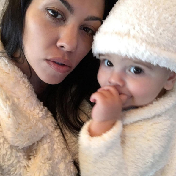 "Kourtney Kardashian shared this cute pic of her and Reign writing: ""First Thanksgiving. #blessed""