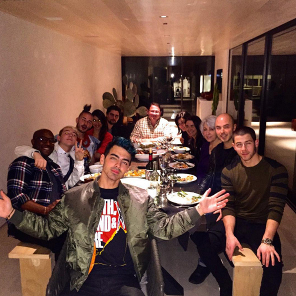 Although he couldn't be in his own house, Joe Jonas made himself at home enjoying a big feast with friends. 