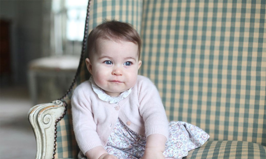 Princess Charlotte posed for mom Kate in her first official solo portrait. In the picture the then 6-month-old wore a $32 dress from Spanish shop m&h.