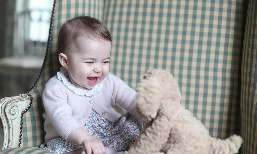 The little girl laughed and giggled as she played with her cuddly dog toy at the family holiday home, Anmer Hall in Norfolk.