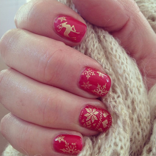 Try a sweater-esque pattern like @lateliersecretdamelie's unique red and gold design. Nail wraps make a great alternative if you don't have time to draw the intricate details.