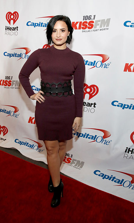 December 1: Looking confident! Demi Lovato worked the red carpet at iHeartRadio's 106.1 KISS FM's Jingle Ball 2015 Presented by Capital One at American Airlines Center in Dallas, Texas.