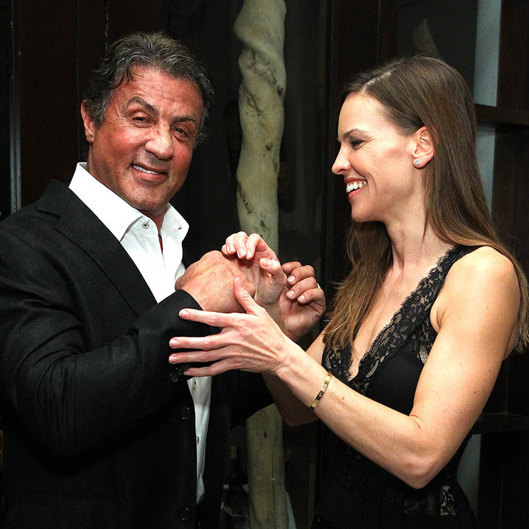 December 1: Put your dukes up! Sylvester Stallone and Hilary Swank attended DuJour Magazine party at Delano Beach Club in Miami. 