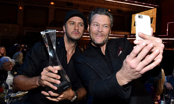 "December 2: Country Boys! Blake Shelton and Luke Bryan celebrated at the 2015 CMT ""Artist of the Year' awards in Nashville. During the event, Luke joked to Us Weekly that his buddy doesn't want him to meet his new lady Gwen Stefani.