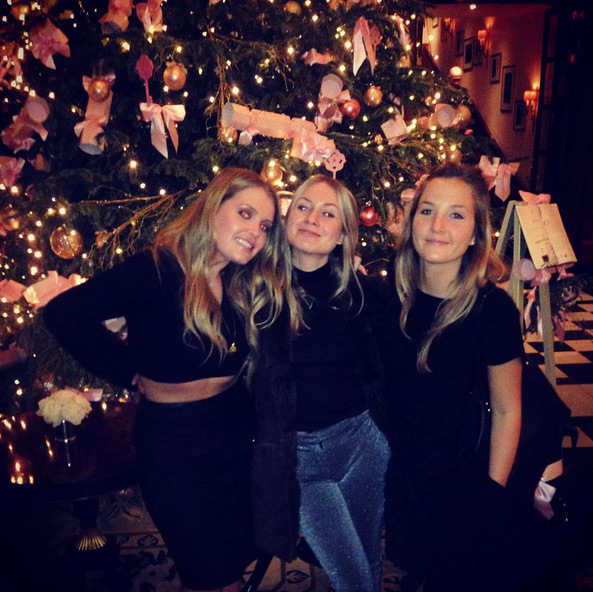 Lady Kitty Spencer, left, was back in London in time for Christmas after her extended vacation Down Under.
