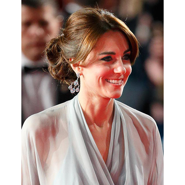 Kate was simply dazzling as she joined Prince William and Prince Harry for the premiere of the new James Bond film 'Spectre' in October. For the event, the elegant royal chose to wear her hair swept up into a chignon, pairing the style with striking dark smoky eye make-up for ultimate red carpet glamour.