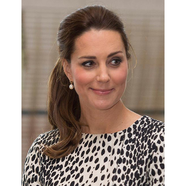A few weeks before she welcomed Princess Charlotte into the world, Kate made quite the impression with her chic dalmatian-print coat dress by Hobbs and an effortless ponytail. 