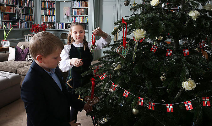 Princess Ingrid and Prince Sverre were captured putting the finishing touches to their beautiful fir Christmas tree.