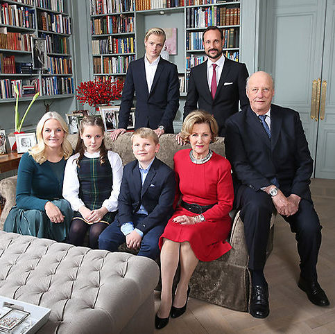 Another shot sees the majority of Norwegian family seated while Crown Prince Haakon stands next to his 18-year-old step-son Marius Borg Høiby - whose tall stature is one of the most notable elements in the shot! 