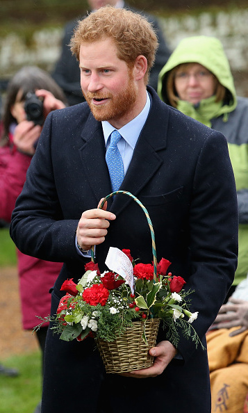 Prince Harry greeted royal watchers (and received flowers!) outside the church.