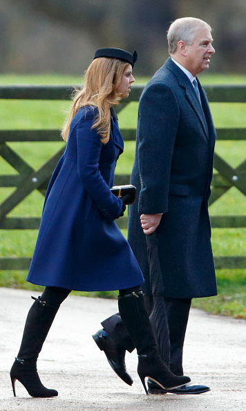 Her Sunday best: Princess Beatrice turned on the style in a blue coat and buckle-embellished boots as she arrived at church with dad Prince Andrew.