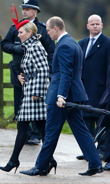 Mike Tindall and wife Zara Phillips, dressed in check-print coat and eye-catching red hat, left their toddler daughter Mia behind to join the family for the church service.