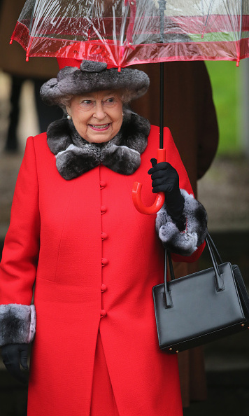 The Queen looked festive in red as she made her way to St. Mary Magdalene church.