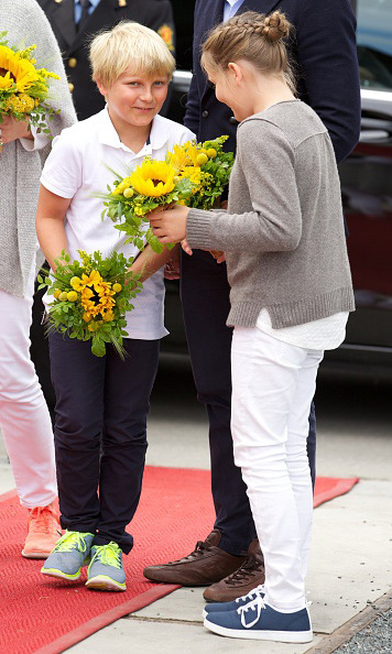 July 2015: Sibling secrets...  Prince Sverre Magnus and Princess Ingrid Alexandra of Norway were snapped during this candid moment at the Saint Olav Festival in Norway. Princess Ingrid is probably complimenting her brother for matching his shoelaces to his bouquet!