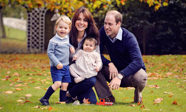 Prince William proudly looked on in the family's Christmas 2015 official portrait.
