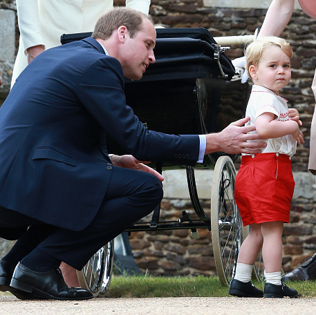 Prince William kept a close eye on the little royal throughout the christening.